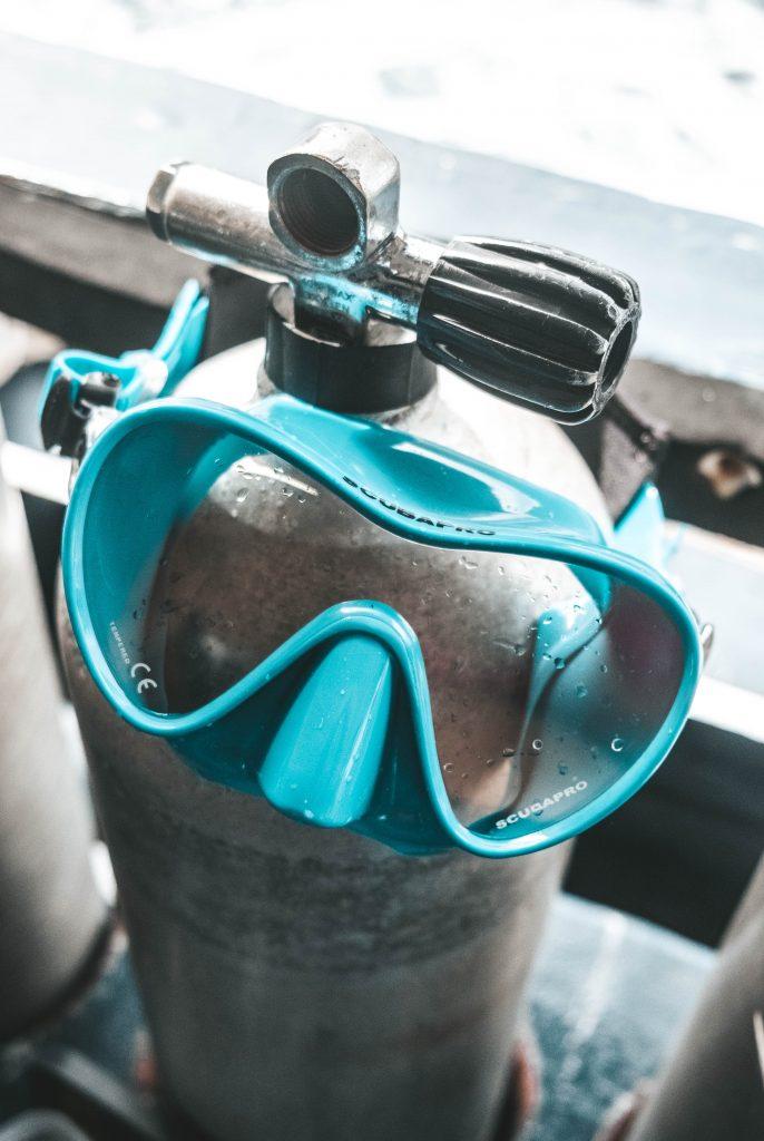 Blue scuba mask on a tank
